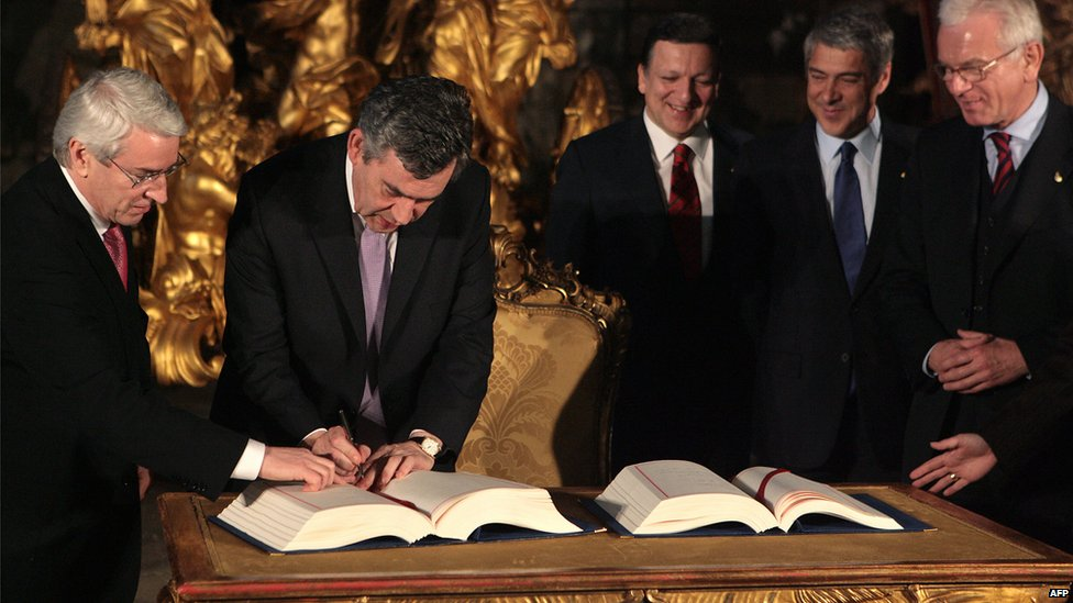 Past UK Primer Minister Brown signs the Lisbon Treaty.
